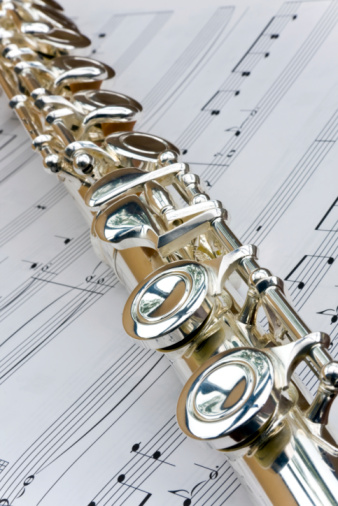 Flute lay across sheet music